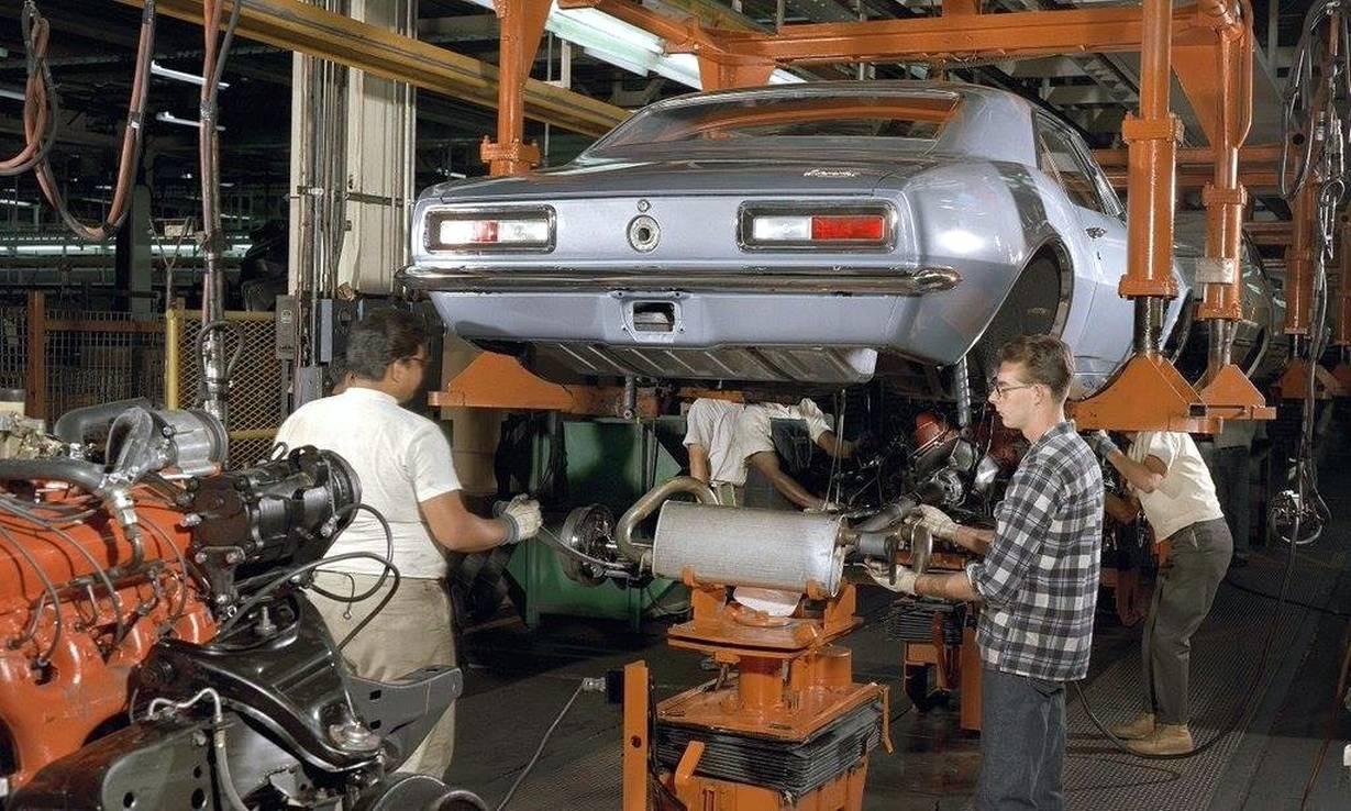 Chassis being raised into the body